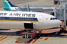 Singapore Airlines A330, 9V-STM being prepared for cargo loading - by dirktraveller