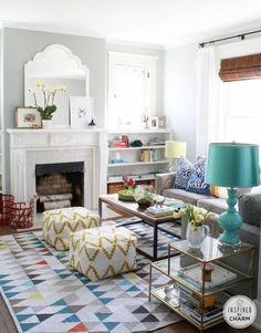 Above the fireplace is Sensible Hue from Sherwin Williams – a shade darker than the wall color, Aloof Gray.