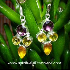 Tri-Stone Yellow Tourmaline, Citrine and Amethyst Handcrafted Earrings - Spiritual Gifts Ireland.   They are handmade, unique and one of a kind.  Slight variations may exist due to the natural stone content.  They are set in Sterling Silver.  Earring length excluding hook: 30mm x 16mm Shop now at www.spiritualgiftsireland.com OR follow us on www.facebook.com/spiritualgiftsireland www.instagram.com/spiritualgiftsireland www.etsy.com/shop/spiritualgiftireland