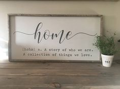 home A story of who we are. A collection of things we love. This beautiful famed sign will add a classic farmhouse touch to any space in your home! This large handcrafted wood sign measures approx. 18 x 36. It is painted white, with letters painted in black. Framing is shown in driftwood, but other framing colors may be requested in order notes. The sign has a hanger is attached to the back. I hand sand, paint, letter & distress each of my signs, giving them a touch of individuality &am...