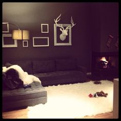 Mary Catherine Brown frames her new fauxidermy deer head above her Vapor sectional.
