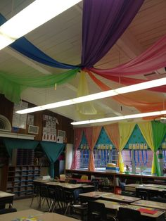 My new decor in my 65 year old classroom. Amazing what some fabric, butcher paper, and plastic table cloths can do!