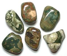 "Tumbled Rhyolite (also known as ""rainforest jasper"") Ignites creative potential. Past-life healing. Enhances self-esteem, self-worth. Helps one deal with challenges."