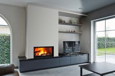 But with open shelving for books underneath Fireplace Tv Wall, Basement Fireplace, Wall Mount Electric Fireplace, Modern Fireplace, Living Room With Fireplace, Fireplace Design, Fireplace Mantels, Fireplaces, Shelving Design