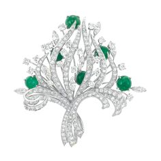 Platinum, Diamond and Cabochon Emerald Brooch The stylized bouquet supported by flared ribbons, set throughout with 182 old European and single-cut and 7 marquise-shaped diamonds approximately 8.35 cts., accented by 6 round cabochon emeralds, approximately 20 dwts.