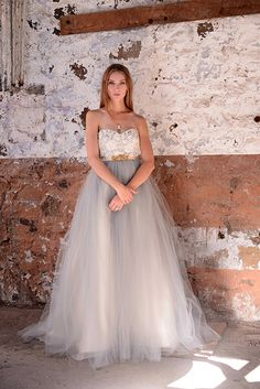 Elizabeth Dye   Halo Gown   Guipure lace and tulle decorate the fitted sweetheart bodice, while luxuriant layers of tulle float to the hem. Silk organza and taffeta under layers add even more pretty. Available with or without attached crinoline to customize fullness. Styled with vintage belt. Available in Glacier or Ivory.
