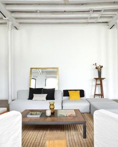 Former textile workshop transformed into a New York-style loft is located in the center of Barcelona, in a century-old industrial building. Original details (rough-hewn beams, double-hung windows) have been preserved, and the interiors have been whitewashed for a unified look. Photo by Jordi Miralles. Catalonia