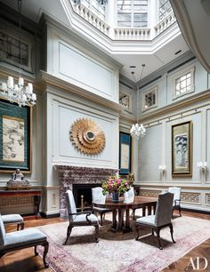 The architecture and design firm Sawyer | Berson reconceived the central atrium of a New York townhouse as a soaring dining area, complete with walls sheathed in raw silk and Japanese ink paintings.