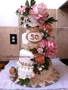 50th Wedding Anniversary cake featuring gum paste peonies and fondant lace.  Cake design by cake artist Teri Lyddiard.