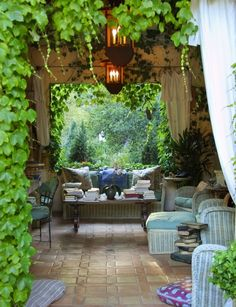 Grapevines, shade, chandelier lighting and a comfy couch=awesome summer nights.