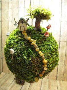 Unusual moss ball string garden. From my what's hot garden board. Miranda x