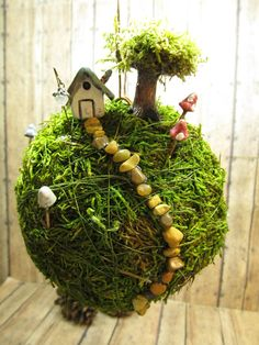 Unusual moss ball string garden. From my what's hot garden board. Miranda x