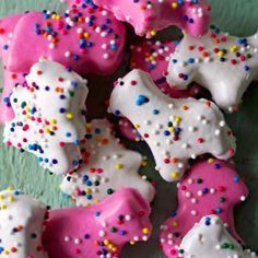 Homemade circus animal cookies, using an almond shortbread that's coated in pink and white chocolate and covered in sprinkles!