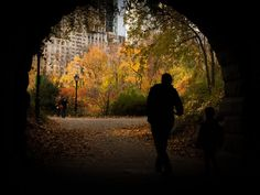 A father and son walking through a tunnel in New York's Central Park ~ Photo by.Victor Mirontschuk/Your Take© >> See The Sun, Park Photos, New York S, Beautiful Scenery, Father And Son, Central Park, Paths, Sunrise, Pictures