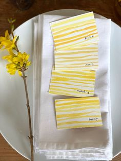 Watercolor place cards with yellow stripes forsythia