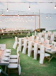 #lighting, #chair-sash, #chair  Photography: Jemma Keech - jemmakeech.com  Read More: http://www.stylemepretty.com/2014/09/11/romantic-cliff-top-wedding-by-the-sea-in-bali/