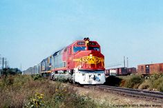 ATSF #5946 (EMD FP45) leads Train #2, The Grand Canyon, just west of the Golden Avenue under-grade bridge at Topeka, KS on November 19, 1970.  Photo by Richard Makse.