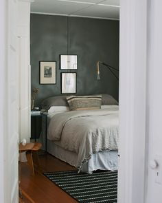 This charcoal wall with the white is oh so nice!  http://www.sfgirlbybay.com/