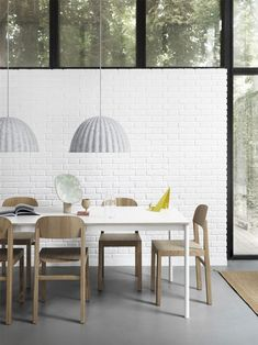 Minimal Scandinavian dining room interior inspiration from Muuto: Under The Bell is a pendant lamp that is multi-functional as the design not only provides an ambient light but also enhances the acoustics of the room. Nachhaltiges Design, Nordic Design, Lamp Design, Design Ideas, Dining Room Lighting, Dining Room Sets, Dining Room Inspiration, Interior Inspiration, Interior Ideas