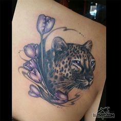 Leopard with Purple Flowers Back Tattoo by Rain at Body Language Tattoo Shop NYC #animaltattoo #flowertattoo #cutetattoo #tattoo