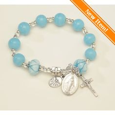 New! Gorgeous pandora-style Miraculous Medal Turquoise Rosary Bracelet. Hand-made, hand-painted glass beads, $36.95. #CatholicCompany