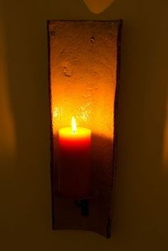 Roof tile candle sconce.
