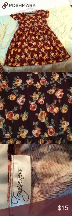 Burgundy Floral Dress Burgundy background with flowers. Flowy dress with tighter waist. Size small but would fit a medium. Purchased from forever 21. Forever 21 Dresses