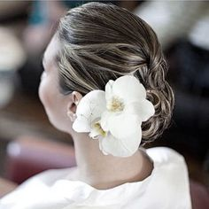 White Orchids in Her Hair |  Infinity Weddings & Events | Photo by Haring