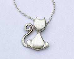 Cat Necklace  tiny silver pendant  by BootyHeartJewelry,   I believe cats to be spirits come to earth. A cat, I am sure, could walk on a cloud without coming through. ~Jules Verne    $48.00