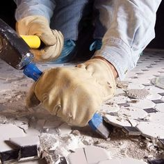 If you don't have room for another layer of tile over an old tile floor, you'll have to scrap off the old tile. It's a tough job, but the right tools will make it go faster.