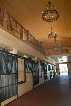 Stable with loft - featuring Classic Equine Equipment's Legend series stalls. Um, I think I could live in this barn!!