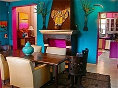 turquoise wall and incredibly cool pink kitchen through the doorways