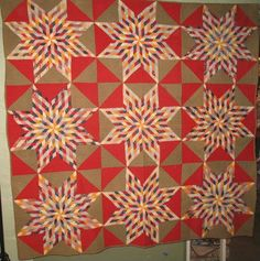 Starburst and Hourglass, 1880. Laura Fisher Quilts.