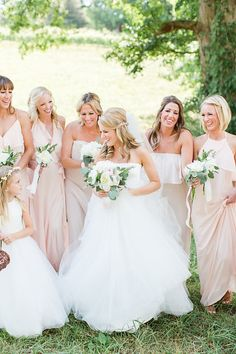 Loved these pretty shades of Amsale Nouvelle bridesmaids dresses. So many styles to choose from!