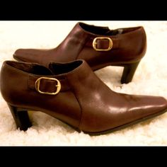 Bandolino Leather Booties Soft Brown Leather These booties are super soft in luxe dark brown leather with gold buckle & side zip. Durable rubber soles with little signs of wear. There is one small area inside the shoe where I had an insert when I removed it; the outer piece of lining peeled off with it but did not tear. Super comfortable with a 3 inch heel you can walk in them all day! Versatile style goes great with your favorite jeans or leggings Bandolino Shoes Ankle Boots & Booties