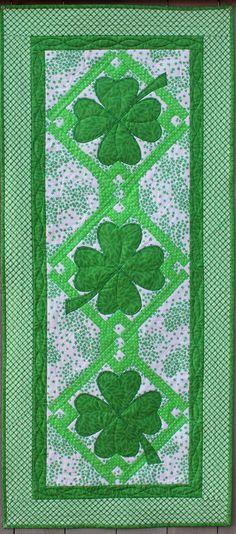 Welcome Spring and celebrate St. Patrick's Day with this lucky quilted table runner and place mat set. Easy-to-piece blocksput the spotlight on four-leaf clovers