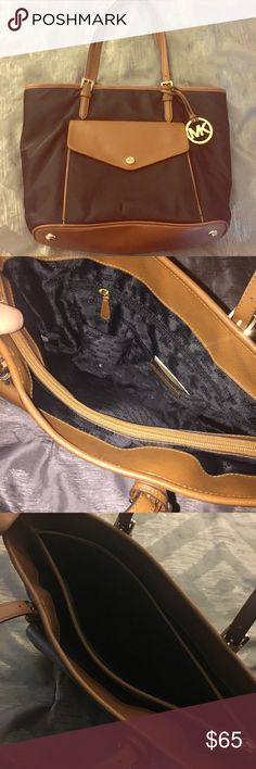"""Michael Kors Jet Set Nylon Large Pocket Tote Brand new but used once in great condition!               Nothing wrong with the purse, just looking for something new 😊.                            Dimensions: 16""""W x 11.5""""H x 6"""" D.                      Outside snap pocket, inside center zip compartment, 1 side zip pocket, 3 open pockets and 1 cell phone pocket                         Also includes Authenticity card in interior side pocket!! Michael Kors Bags Shoulder Bags"""