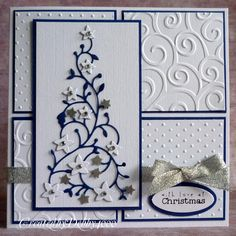 "Original pinner said ""This is the Flowering Christmas tree which I cut out twice and cut the flowers out and then punched some stars. I used the sketch from Friday Sketch Challenge from last week but used embossed mats. A bit of silver ribbon and a craftwork card sentiment to finish."""