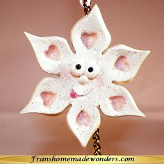 HANDMADE SNOWFLAKE CHRISTMAS ORNAMENTS - HEARTS IMPRESSIONS $7.00  These ornaments are entirely handmade of polymer clay.  Each snowflake has a cute funny face with its tongue sticking out of its mouth.  They also have Swarovski crystal eyes and heart impressions at the end of each point and an attached hanger.  Each ornament is approximately 2 ½ inches across. Personalization also available for NO additional charge.  Order at www.franshomemadewonders.com