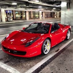 This Ferrari 458 brightens up this parking lot