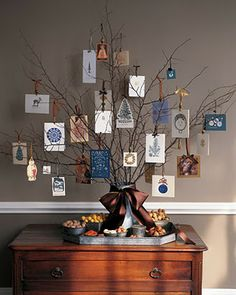 Christmas Card display - Using some branches found outside and a large vase, arrange your Christmas cards tied with ribbon to make a card tree.  This unique display will be sure to have your guests talking