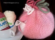 Free pattern @ FitzBirch Crafts: Mrs Potts Pink Tea Cosy - moss stitch with i-cord embellishment
