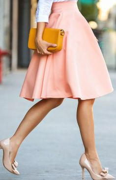 knee length skirt in blush is an absolute gorgeous colour to wear for summer and summer weddings
