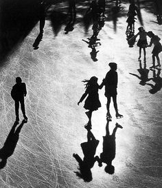 Rockefeller Center ice rink, New York, 1951 by Benn Mitchell #silhouettes #photography #black/white