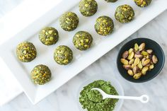 Enjoy the health benefits of matcha with these matcha pistachio bliss balls! They're the perfect combination of matcha green tea, pistachios and dates for a power packed little ball of goodness