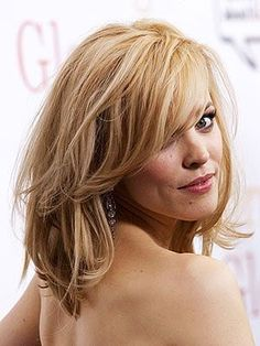 Awesome Women's Jewelry: Rachel McAdams medium hairstyle. All-over layers create volume and glamour, while side bangs keep the look soft around the face.