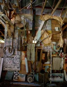 The cluttered wall of the barn studio looks almost like a piece of art itself.