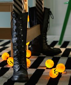 ext: Close-up of high boots used as decoration on the dining table legs.