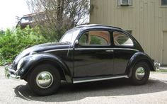 First Car:  Black 1961 VW Bug (Beetle) with rag sunroof.  Loved this car.