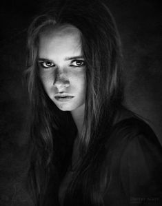 Mistrust, burning anger. Great model, great expression, nice lighting. I love the darkness in this photo.    Model